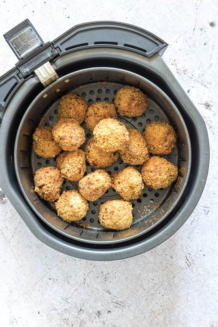 cooked mac and cheese balls inside the air fryer