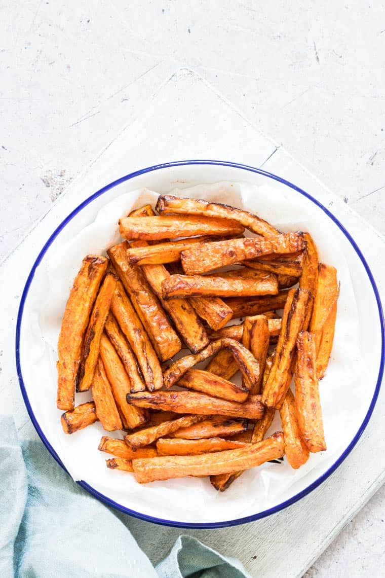 close up view of air fried carrot fries in a bowl