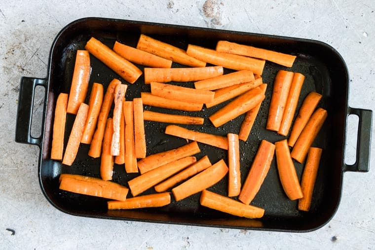 carrot fries placed on a baking tray