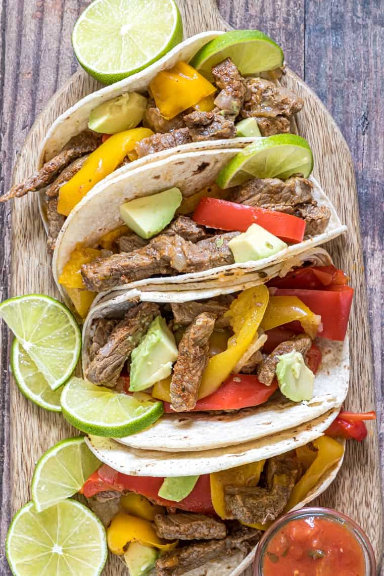steak fajitas instant pot method served with tortillas and various toppings