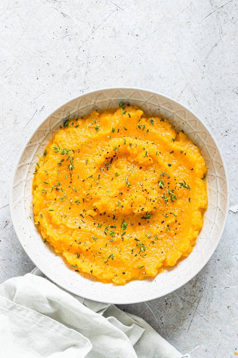 a bowl filled with slow cooker butternut squash mash