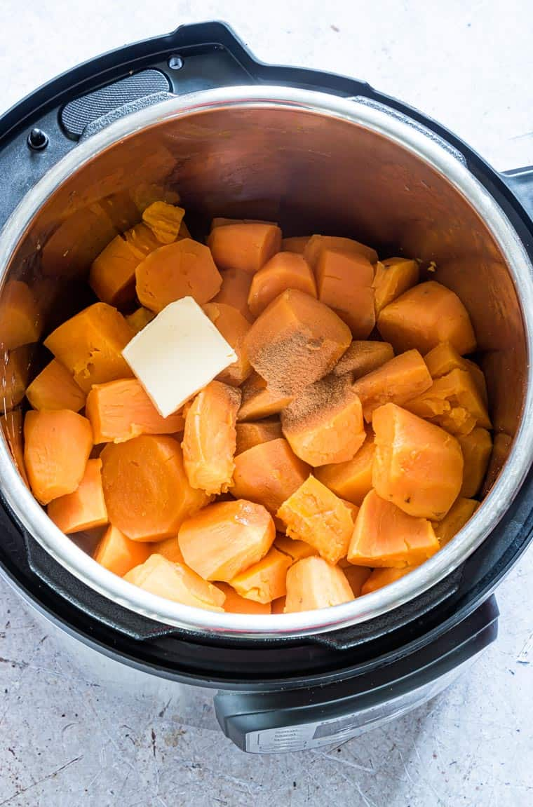 sweet potatoes, butter and spices inside the instant pot and ready to be cooked