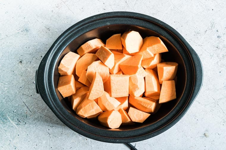 cubed sweet potatoes inside the slow cooker