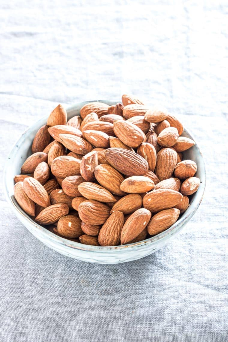 a ceramic bowl filled with air fryer roasted almonds