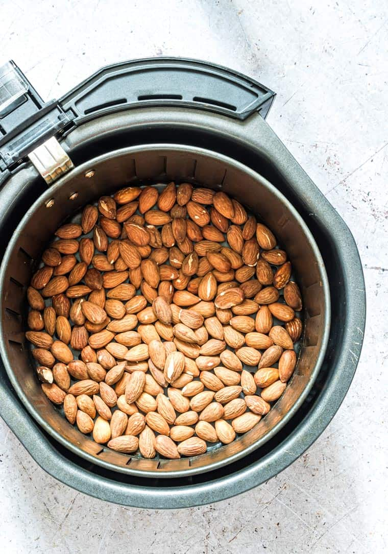 top down view of the roasted almonds inside the air fryer basket