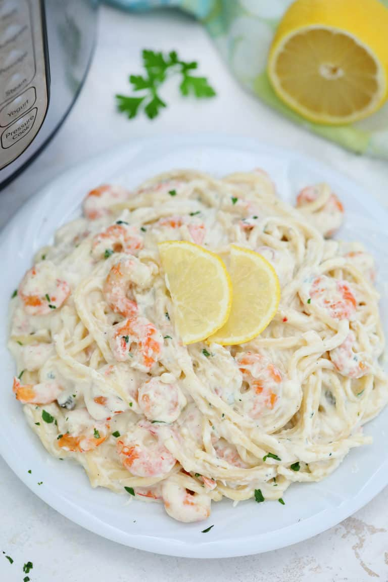 close up view of a plate of instant pot shrimp alfredo