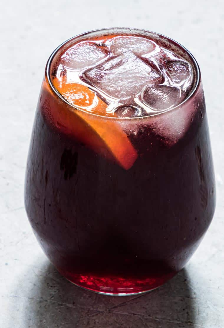 close up view of a glass filled with Jamaican sorrel drink