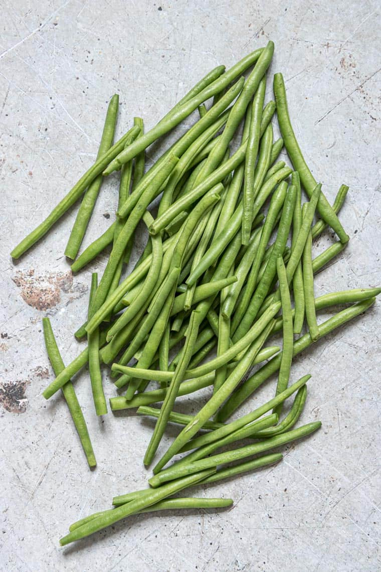 close up of fresh green beans on a counter top