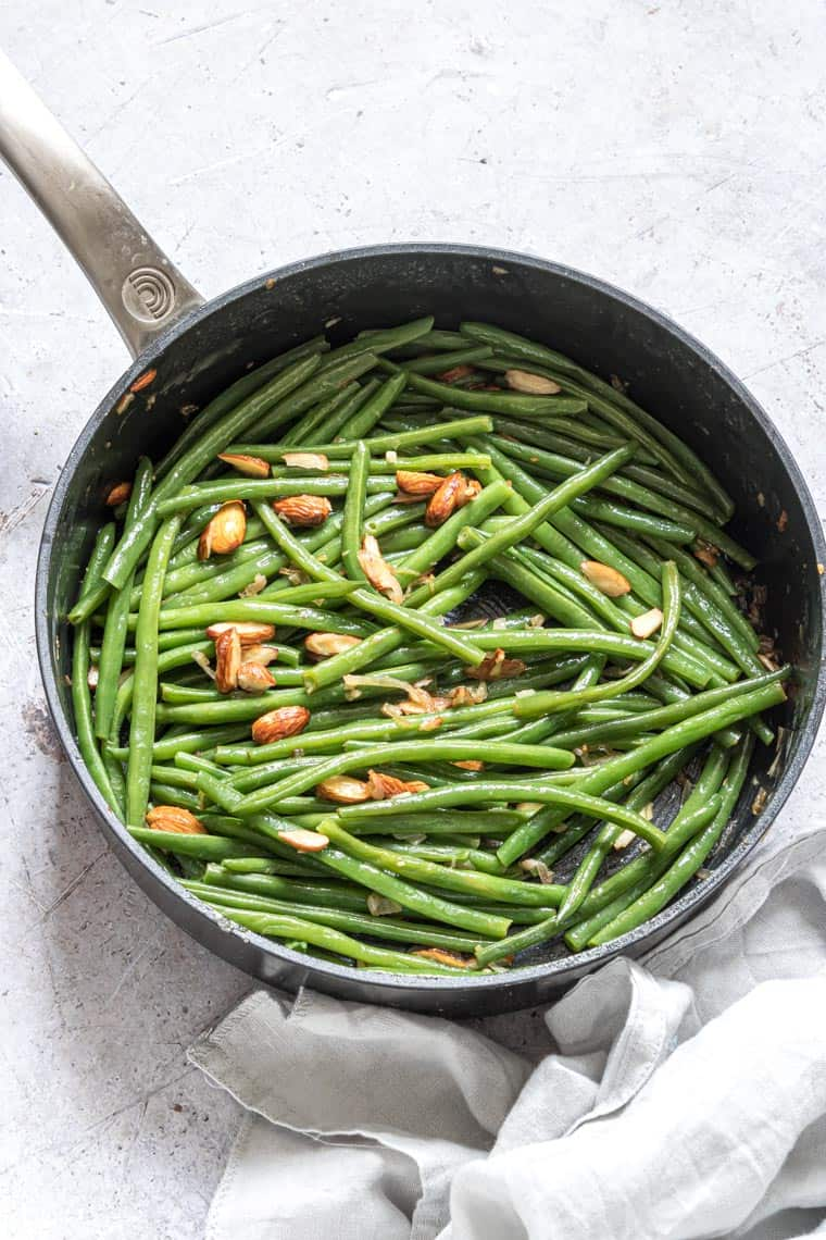 green beans almondine in a pan and ready to be served