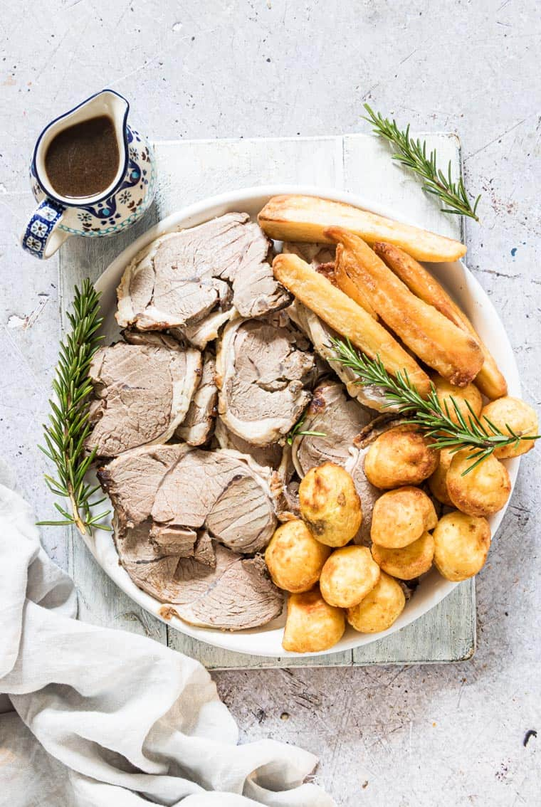 Juicy lamb roast with roasted vegetables and gravy
