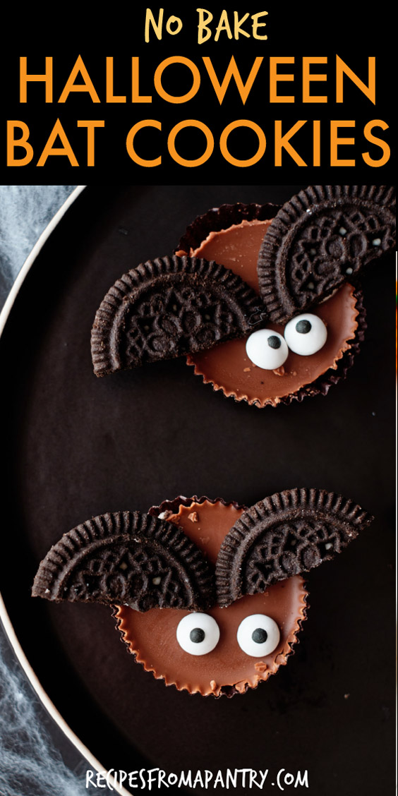 two bat cookies sitting on a plate