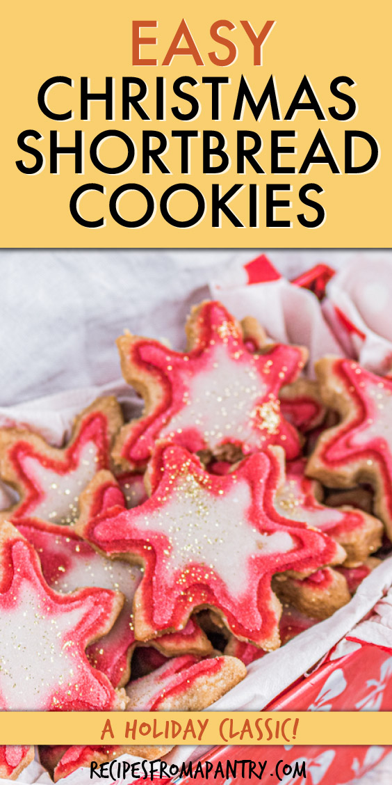 a bunch of star-shaped shortbread cookies in a box with white tissue paper