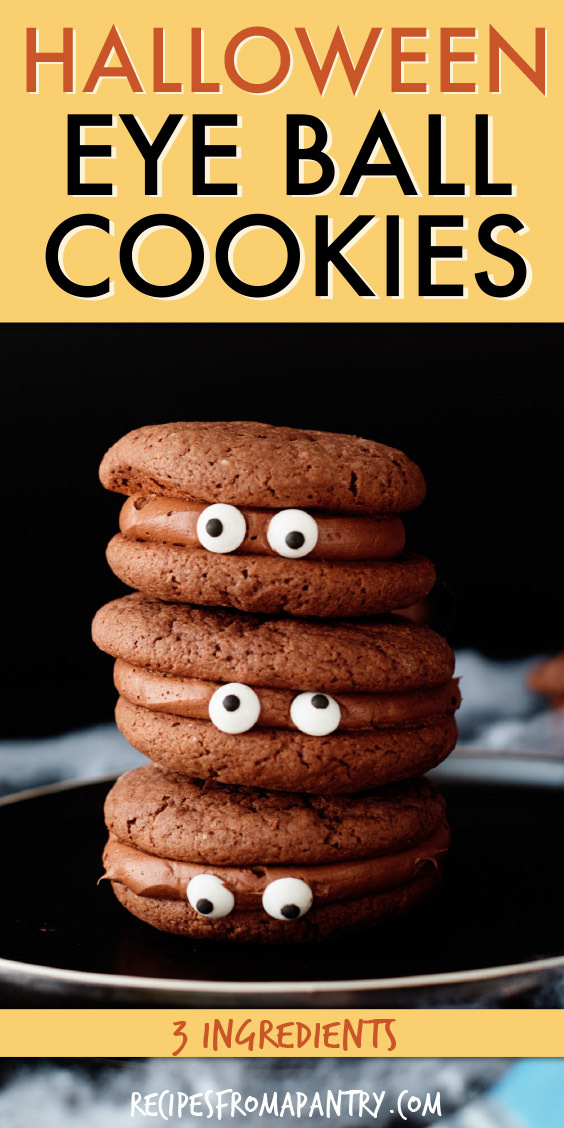 a vertical stack of 3 chocolate cookies with candy eyes
