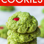 a vertical stack of four green grinch cookies