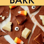 close up of broken bits of chocolate bark with halloween candy