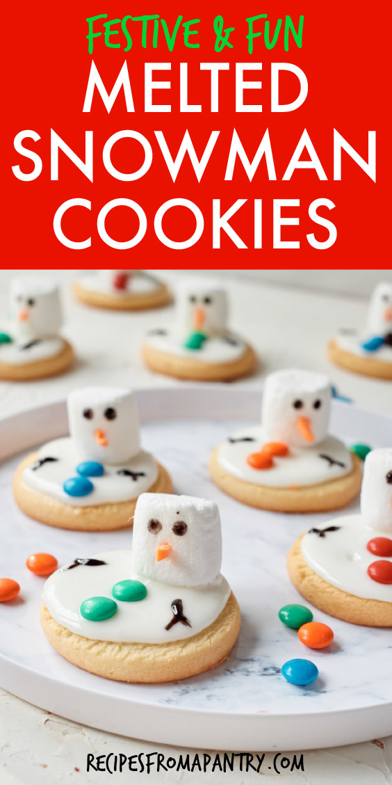 several snowman cookies on a round plate