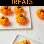 a small stack of pumpkin shaped rice krispies treats on a square plate