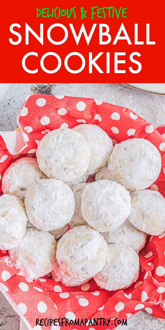 snowball cookies in a basket with polka dot tissue paper.