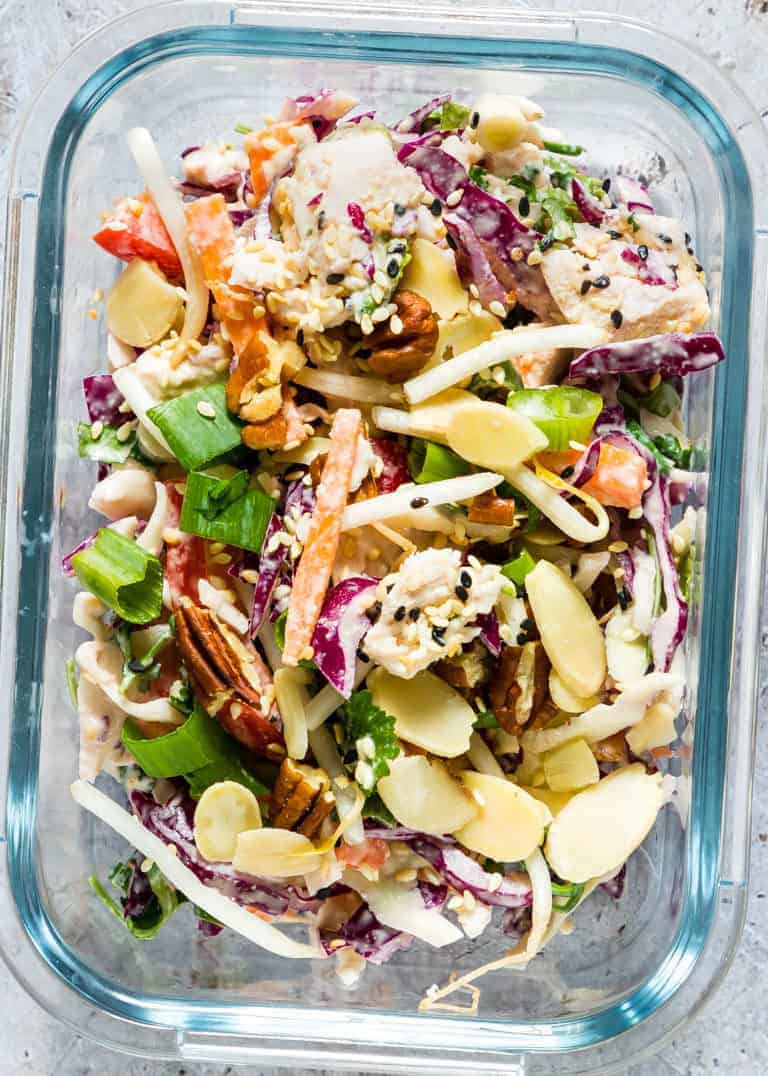 close up of turkey salad recipe with colourful veggies, almonds and pecans