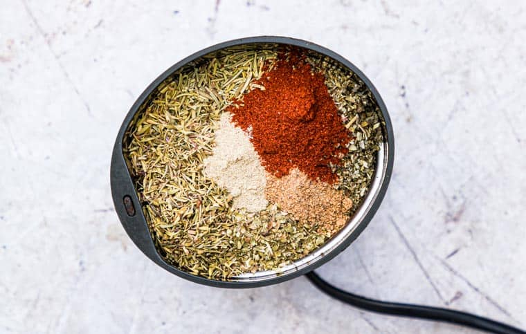 Ingredients to make poultry seasoning in a spice grinder