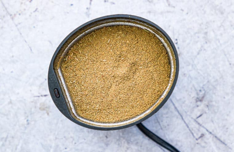 Homemade poultry seasoning ground up in a spice grinder