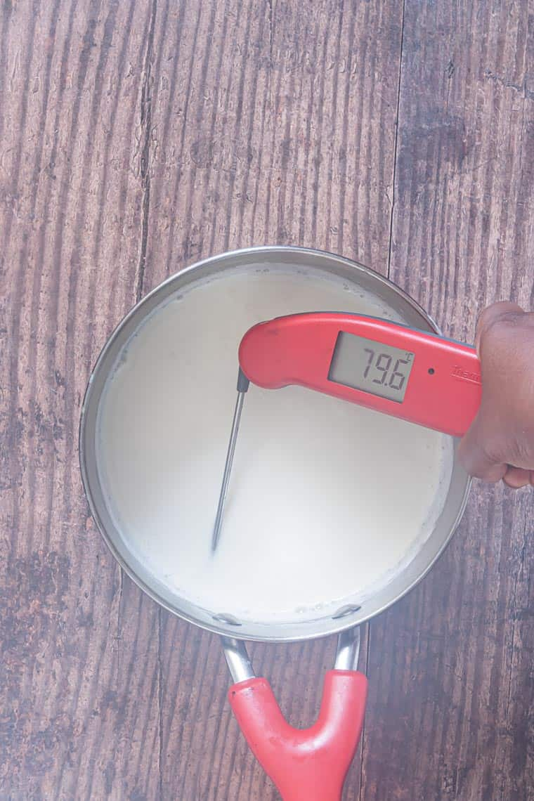 thermometer inside a pan of scalded milk