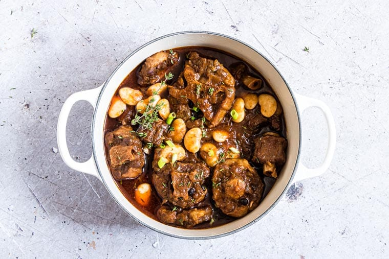 Jamaican Oxtail recipe in a white ceramic dish
