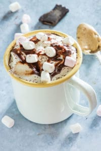 a mug of peanut butter hot chocolate with marshmallows