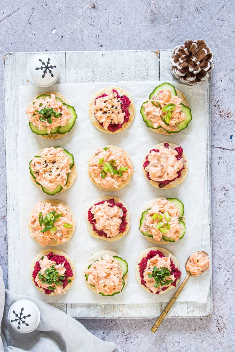 assembled salmon blinis with Christmas decor and ready to serve
