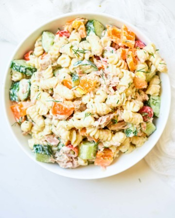 close up of creamy tuna pasta salad with vegetables
