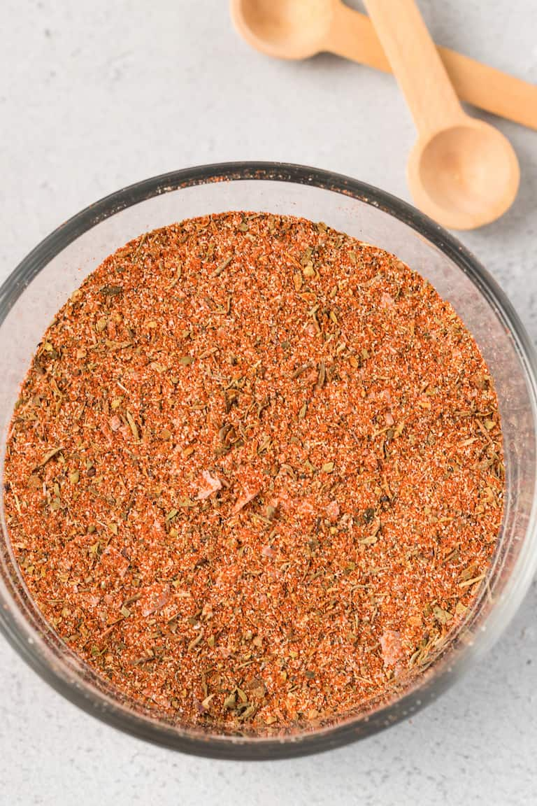 close up view of homemade seasoning mix in a glass bowl