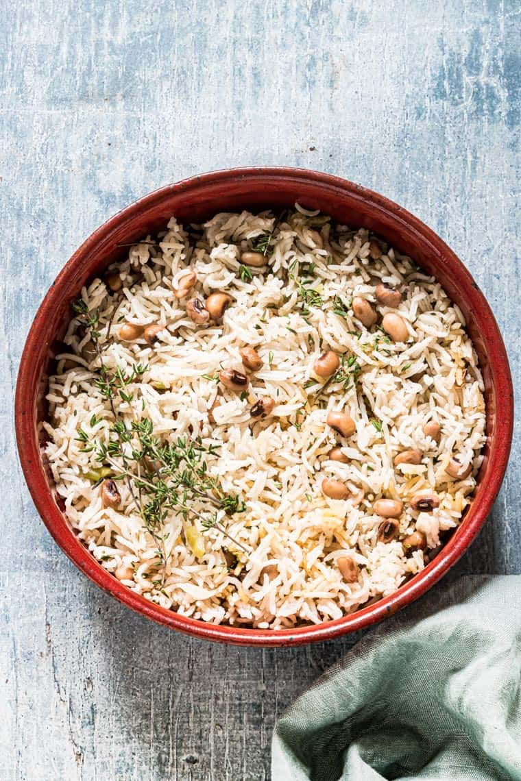jamaican rice and peas in a red bowl
