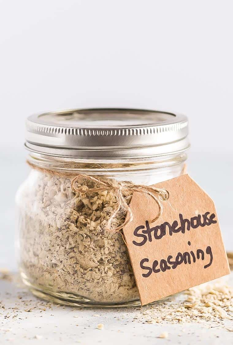 Close up of a jar of stone house seasoning with a gift label