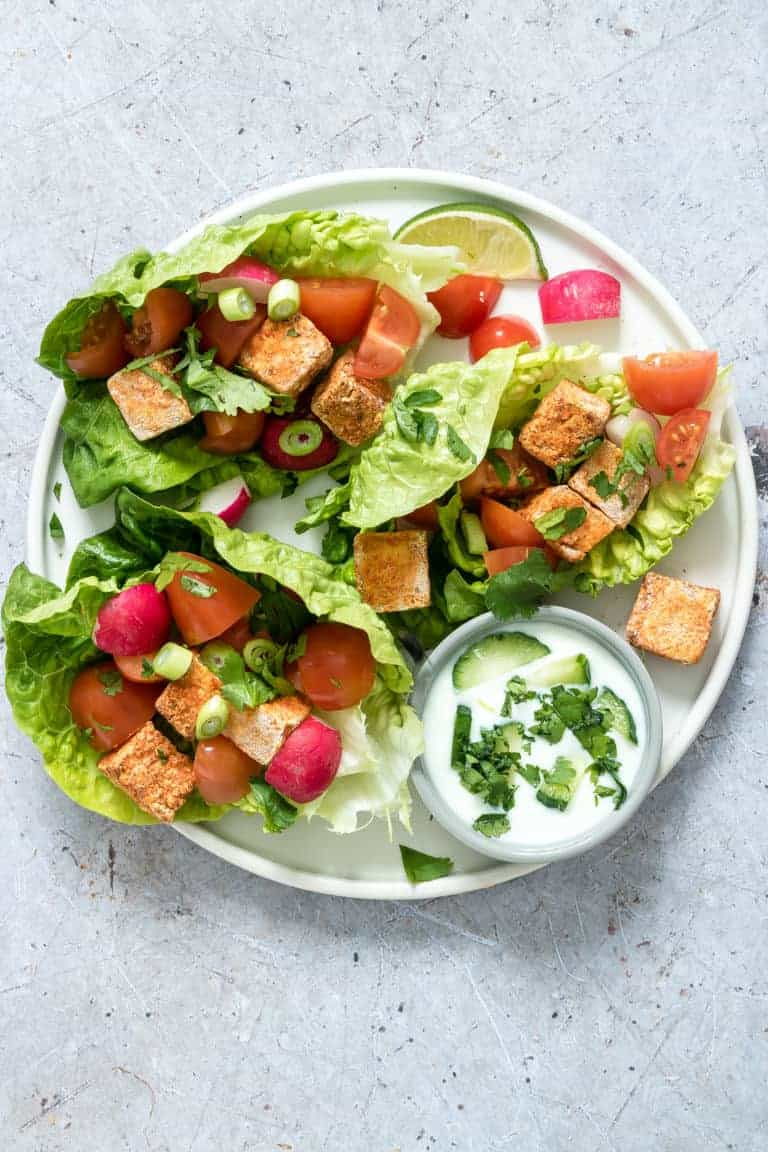Crispy Air Fryer Tofu made into a tofu salad along with lettuce, tomato and green onions