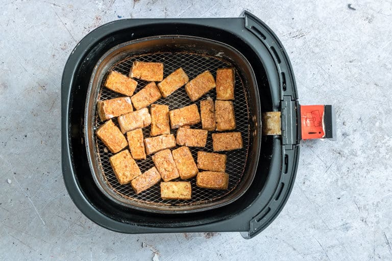cooked Air Fryer Tofu inside the air fryer basket