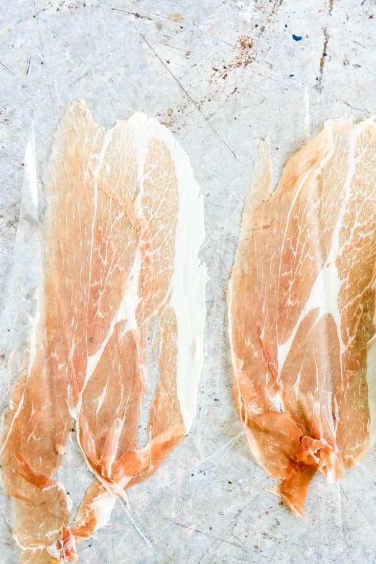 prosciutto ham sliced thin on counter to be used in cheesy quinoa porridge