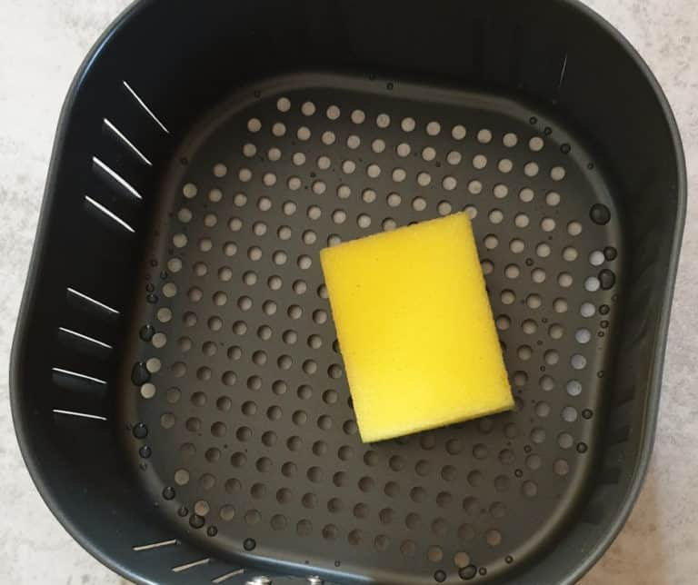cleaning an air fryer basket with a non abrasive sponge