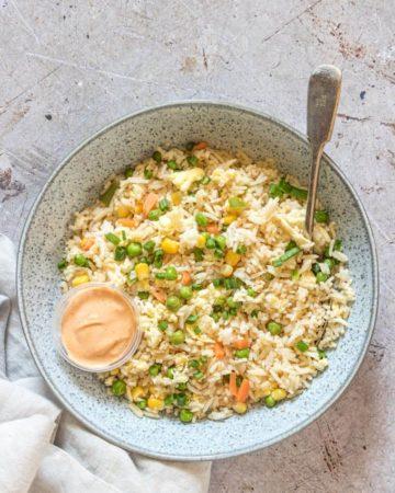A bowl of Hibachi Fried Rice Wth Yum Yum Sauce