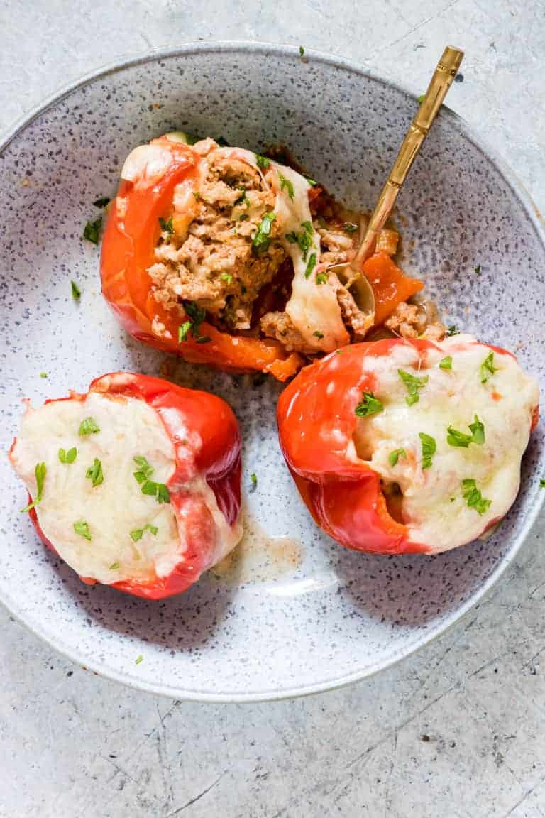 3 pressure cooker stuffed pepper in a bowl with a spoon