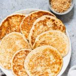 Looking for the perfect keto pancakes? You've found them in this light and fluffy ketogenic pancakes recipe made with cream cheese, almond flour, eggs, vanilla, and nutmeg. Also a gluten free pancakes recipe. #keto #ketodiet #ketorecipes #ketopancakes #ketogenicpancakes #glutenfree