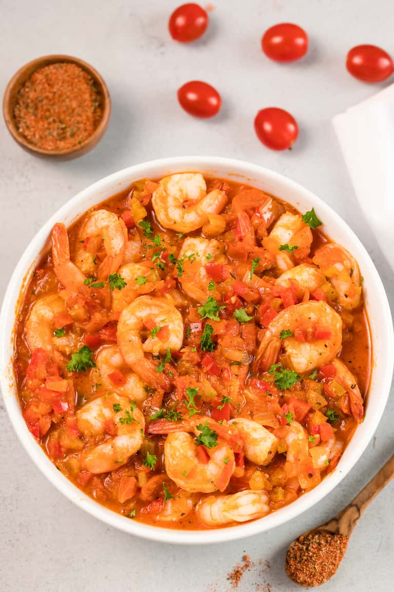 top down view of shrimp creole in a white bowl