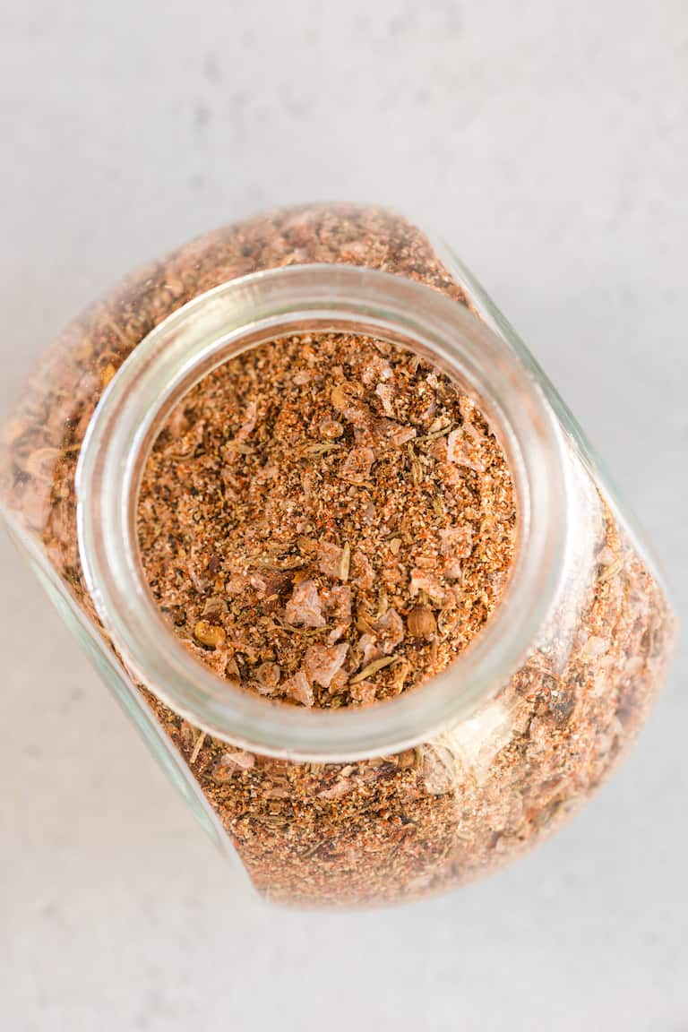 top down view of glass storage jar filled with steak seasoning