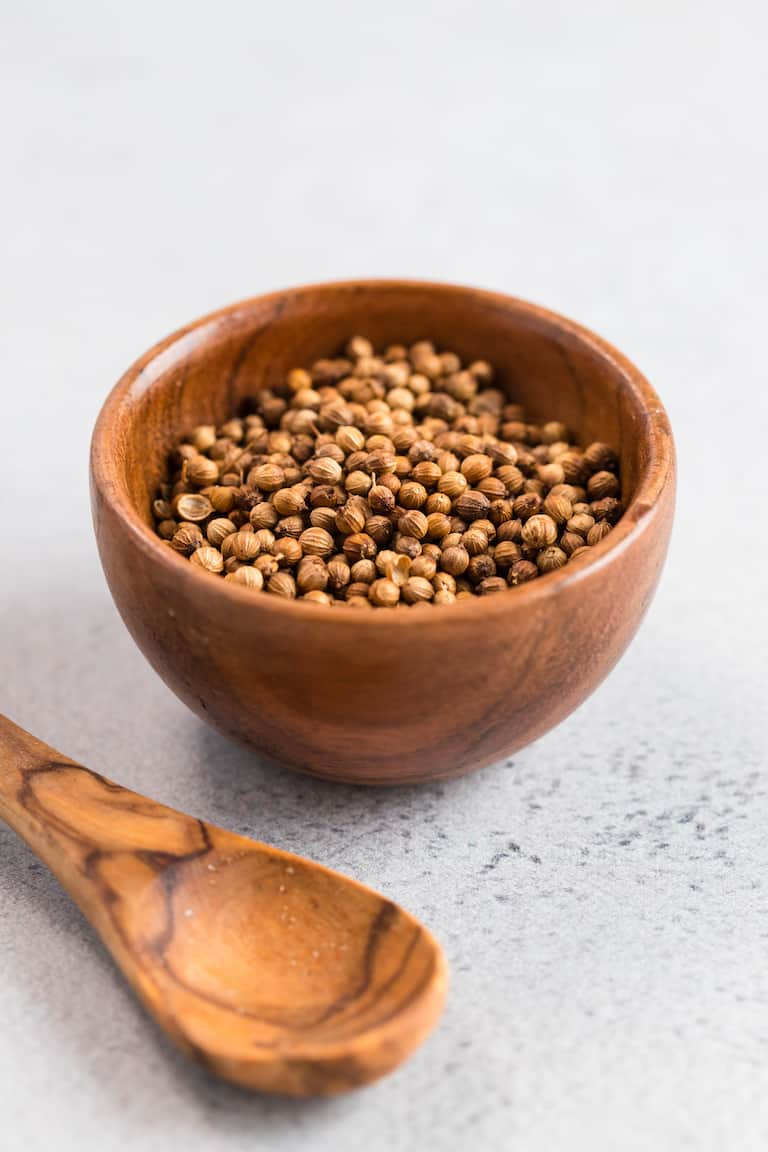 a bowl of coriander used to make steak seasoning