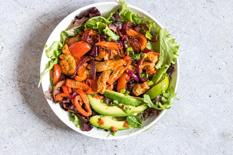 a bowl of chicken fajita salad ready to be served