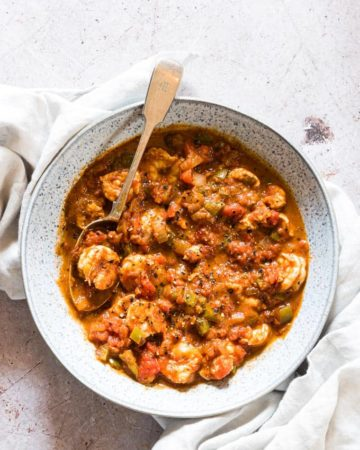 shrimp creole served in a bowl with a spoon