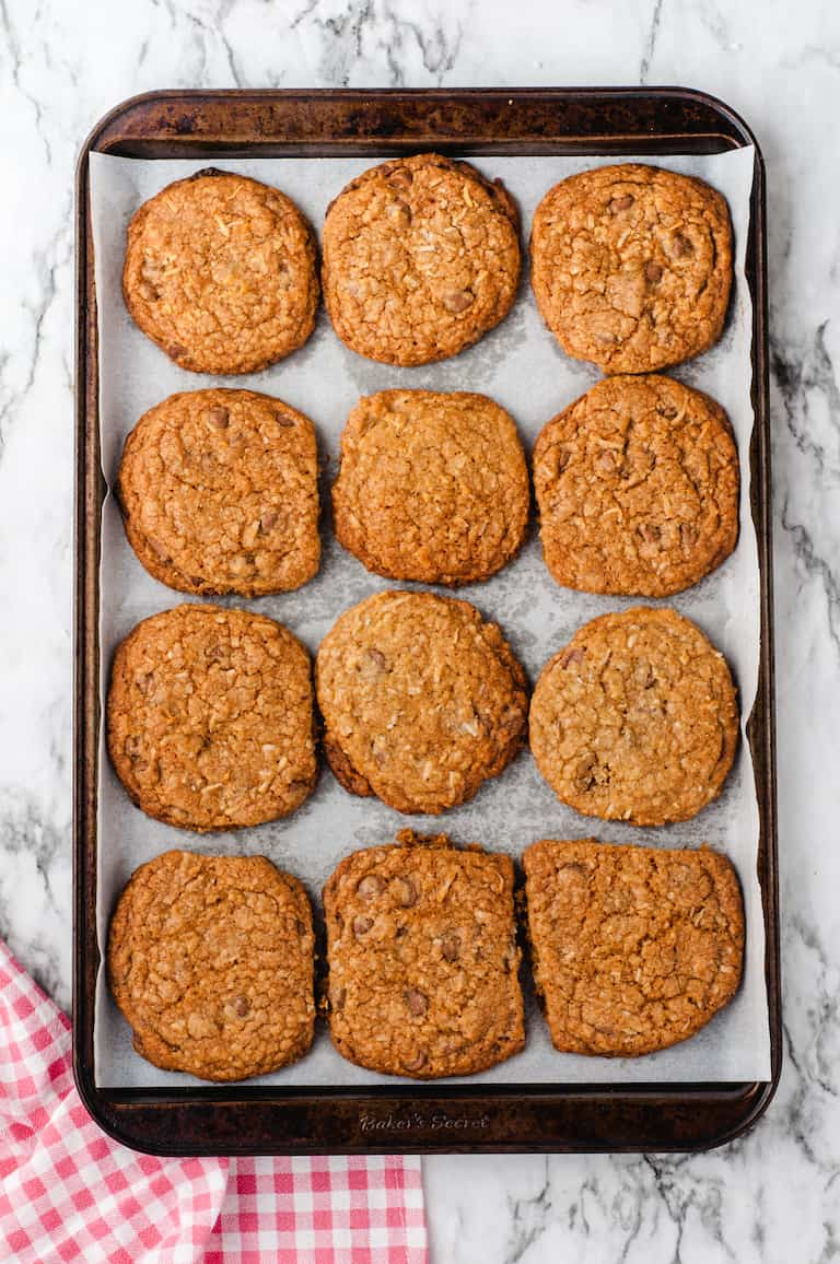 top down view of cooked oatmeal cookies on baking sheet