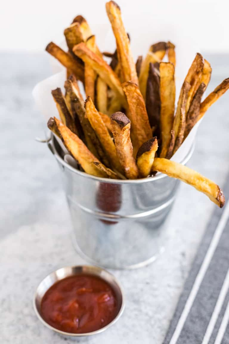 air fryer french fries in a silver bucket