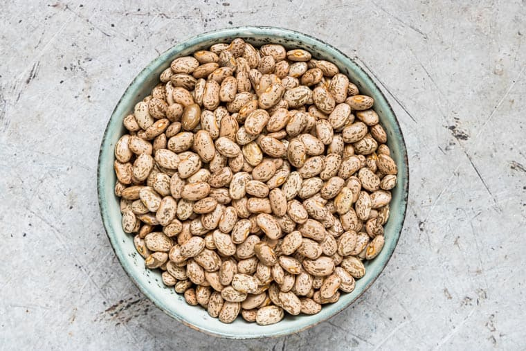 a bowl of dried pinto beans to use to make instant pot pinto beans