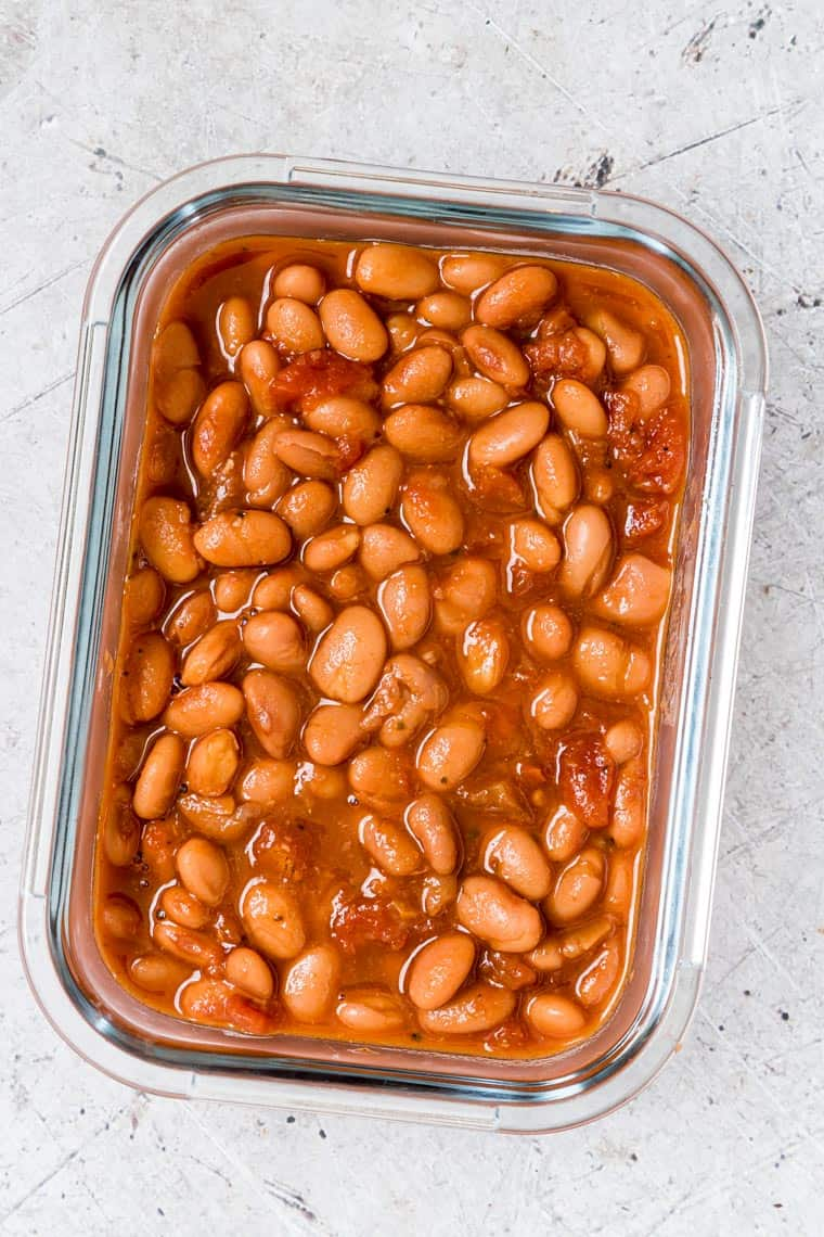 glass meal prep container filled with instant pot pinto beans