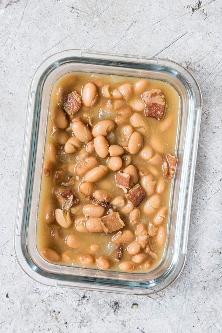 glass meal prep container filled with cooked pinto beans